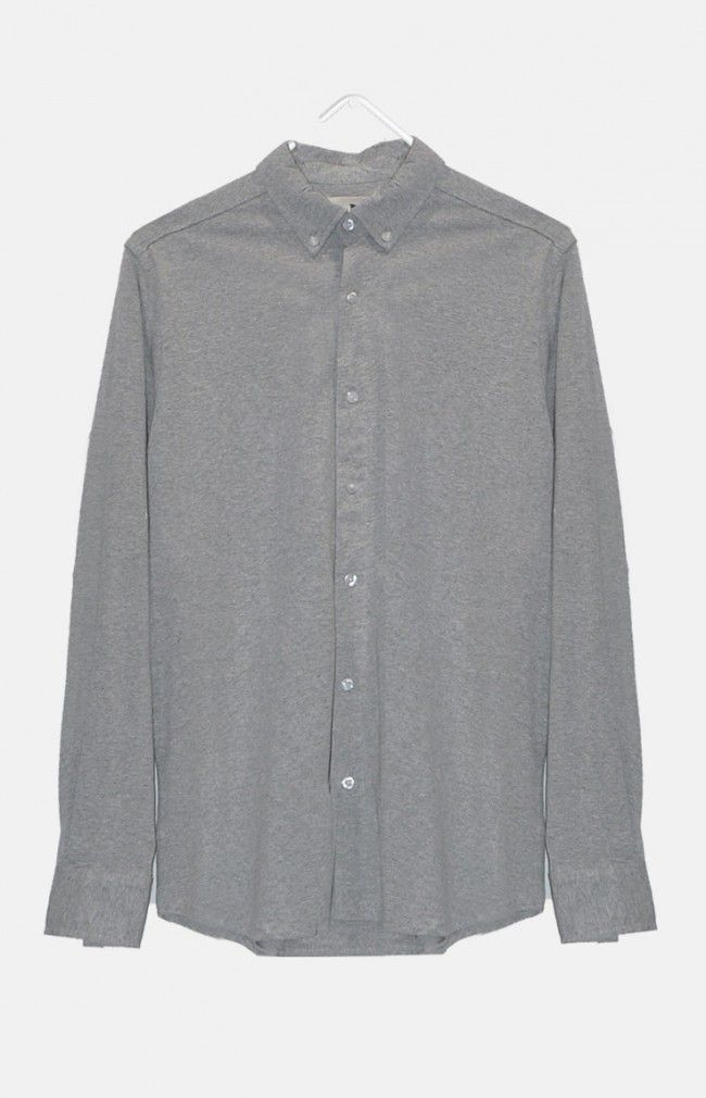 SHAW from WeMoto is a long sleeve Jersey style shirt with collar featuring a single chest pocket and rounded hem.