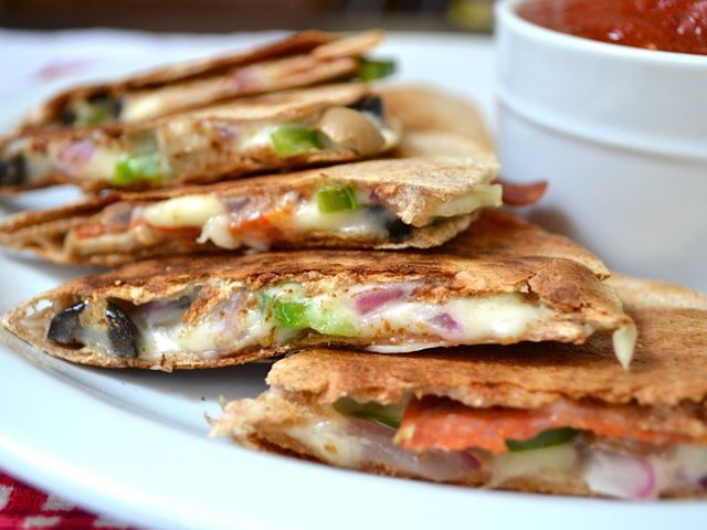 All the cheesy toppings of a pizza stuffed into a fast, easy, and crispy quesadilla. Perfect for dipping in pizza sauce! Step by step photos.
