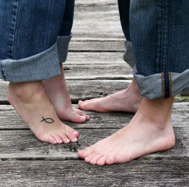 Christian fish tattoo on the foot