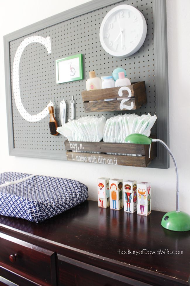 Pegboard Changing Station - love the wooden crate diaper holder!