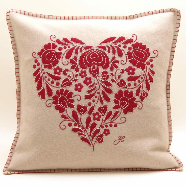 Crafted in beautiful pure cream wool and hand-embroidered with a red Romany heart – composed of tiny interwoven hearts and leaves – this is a romantic item, and a stunning piece of alternative filigree. Jan Constantine  - Romany Heart Cushion, £82.00 (http://www.janconstantine.com/romany-heart-cushion/)