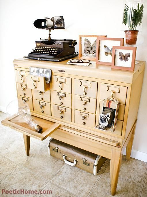 I have always wanted a card catalog in my house.  This picture makes me want to dewey decimal our DVDs