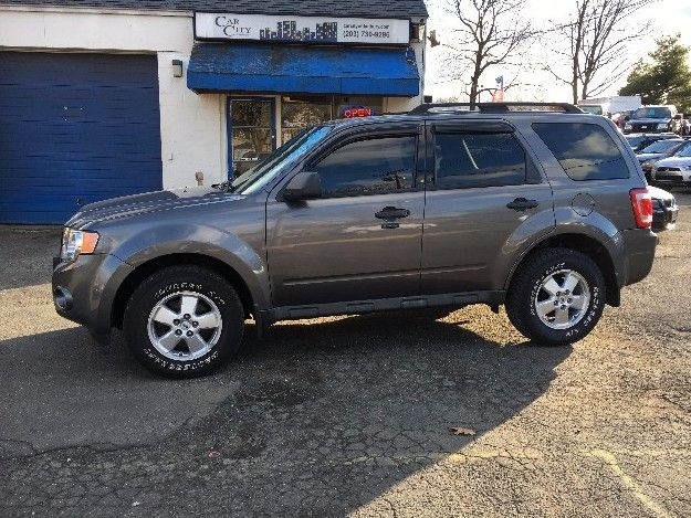 Check out this 2009 Ford Escape XLT Only 71k miles. Guaranteed Credit Approval or the vehicle is free!!! Call us: (203) 730-9296 for an EZ Approval.$9,995.00.