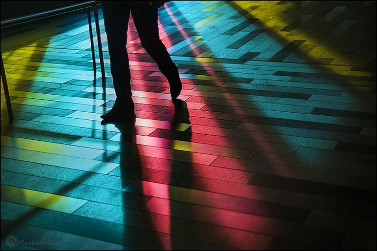 Trip the Light - Palais des Congrès - Montreal, Quebec, Canada - I was photographing the light reflections at Palais des Congrès when all of a sudden this dude walks through my scene. I only had time to take 1 frame but I dig how his legs and shadows cut through the light.
