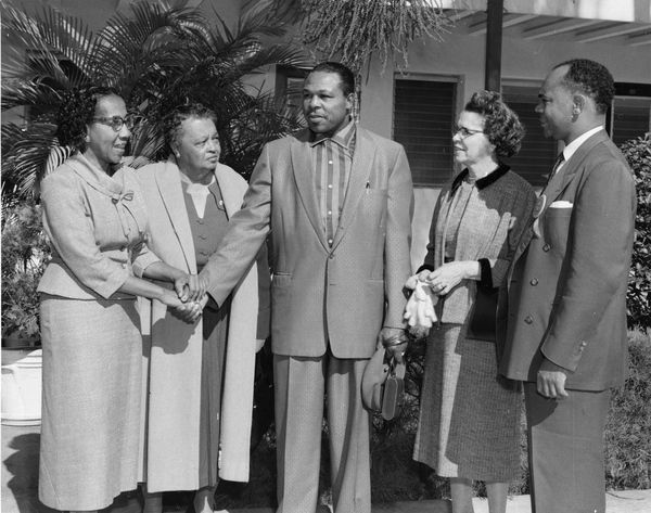 A group meeting light heavyweight boxing champion Archie Moore on FAMU's campus in Tallahassee (1950s). | Florida Memory