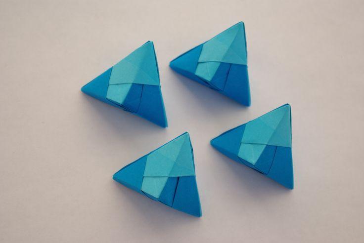 Blue paper origami pyramids