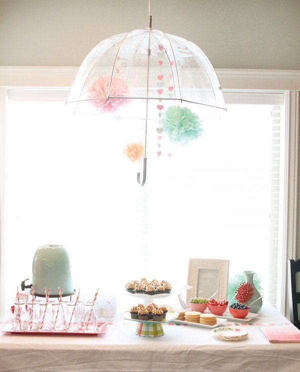 """Bridal shower decorations - """"shower""""-themed party with pastels and hanging umbrella {Courtesy of Hostess with the Mostess}."""
