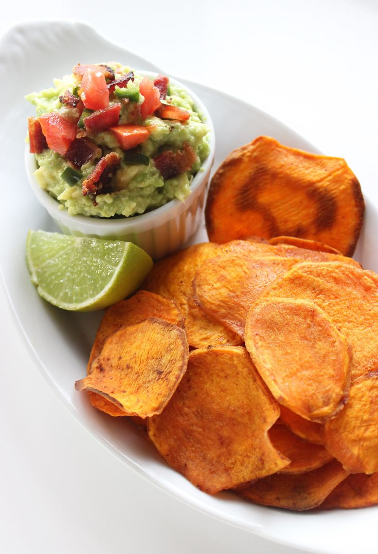 Thinly sliced sweet potatoes are baked into the perfect thin crisp, then taken for a dip in spicy guacamole full of minced chili and crispy bacon. YUM.