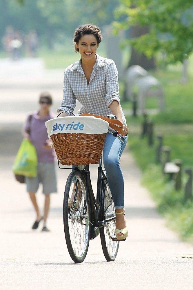 Kelly Brook rides a bike in Regents Park, London, UK.
