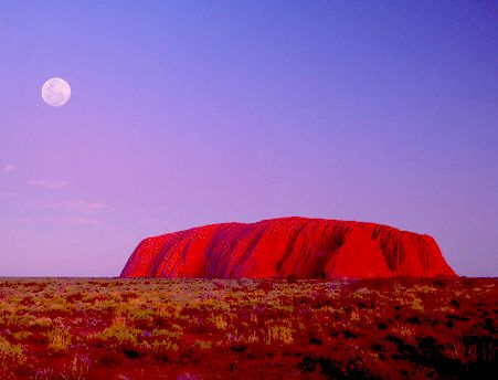 Uluru, also known as Ayers Rock, is one of the oldest sandstone formations on earth. It is located in Uluru-Kata Tjura National Park,  in central Australia. It has many springs, waterholes, rock caves and ancient paintings.