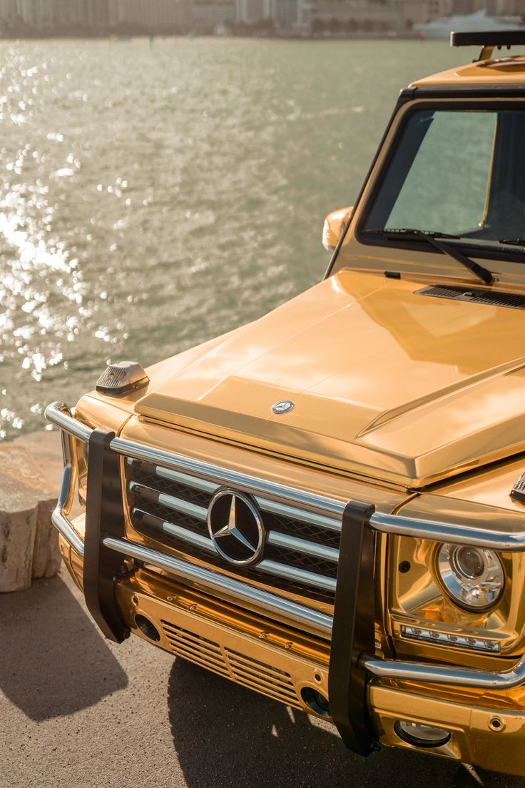 With a mercedes benz g class in gold