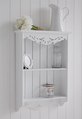 Shelves White Walls And Entry Ways: Side Photograph Of White Wall Shelf With Two Shelves And Pegs For Hanging. Pretty White Wall