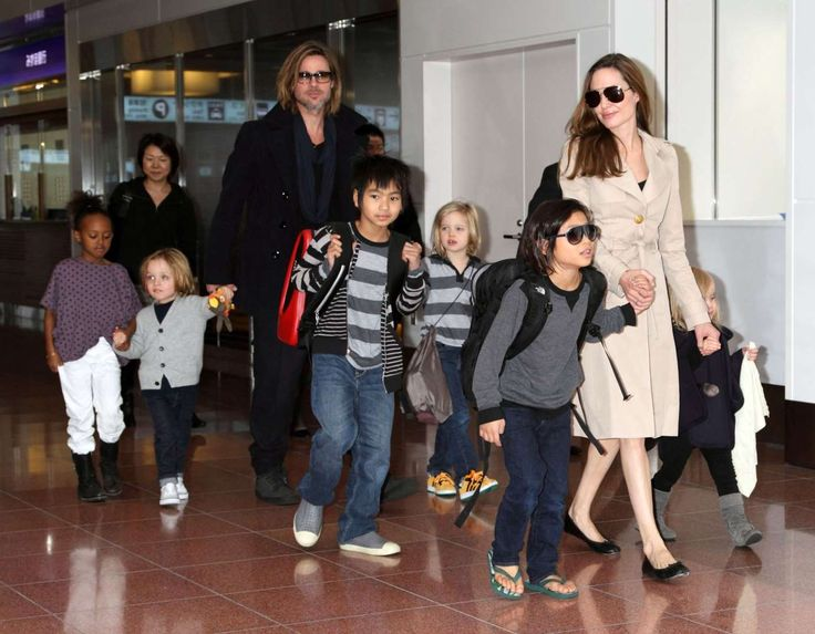 Angelina Jolie and Brad Pitt's journey as a couple:      Before meeting Pitt, Jolie had adopted her first child, son Maddox, from Cambodia in 2002. Between 2005 and 2007, she adopted two more kids — Zahara from Ethiopia and Pax from Vietnam. Pitt formally adopted the kids as his own in 2006. ﴾Pictured﴿ Brad Pitt and Angelina Jolie leave an airport in Japan with their children on Nov. 8, 2011.