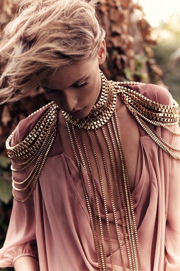 Necklace/shoulder pads extravaganza.