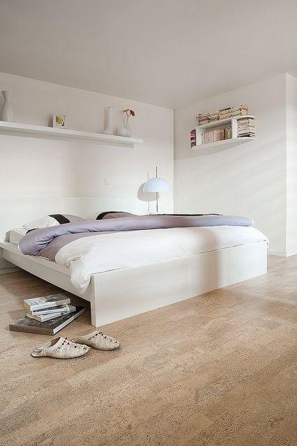 Cork flooring looks great in this simplistic bedroom.