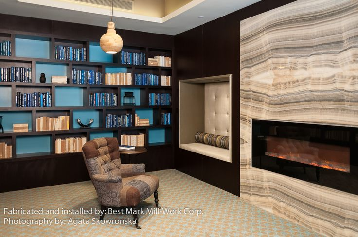 101 Bedford Library onyx slabs fireplace surround and upholstered seating nooks on either side