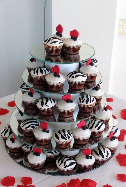 I think I would like a cupcake stand with a small cake on top instead of a wedding cake.