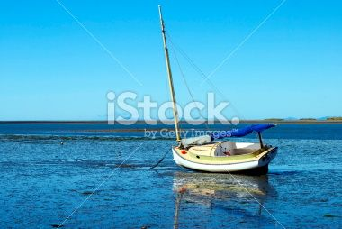 Boatscape and Reflection at lowtide. Royalty Free Stock Photo