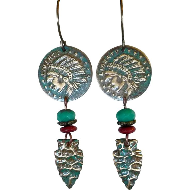 Liberty Indian Coin And Arrowhead Earrings Get your Boho, southwestern, look on with these Native-American inspired long earrings. An antiqued brass reproduction of a liberty indian coin and arrowhead to which I've added a teal patina with a copper wash to give it a bit of an antique look. Perfect to wear everyday or to give as a gift. -19.5mm Liberty Indian Coin charm - 6mm teal czech glass bead - 8mm brown howlite roundel - 19x10mm Native Arrowhead charm.