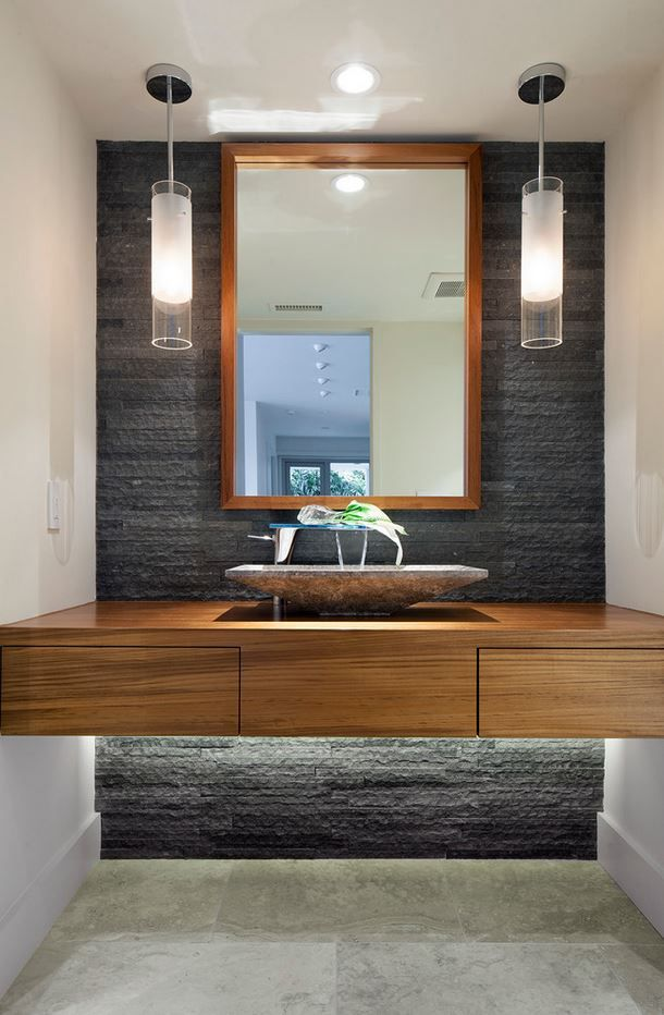 Awesome bathroom decor! A vanity with a hidden light feature!