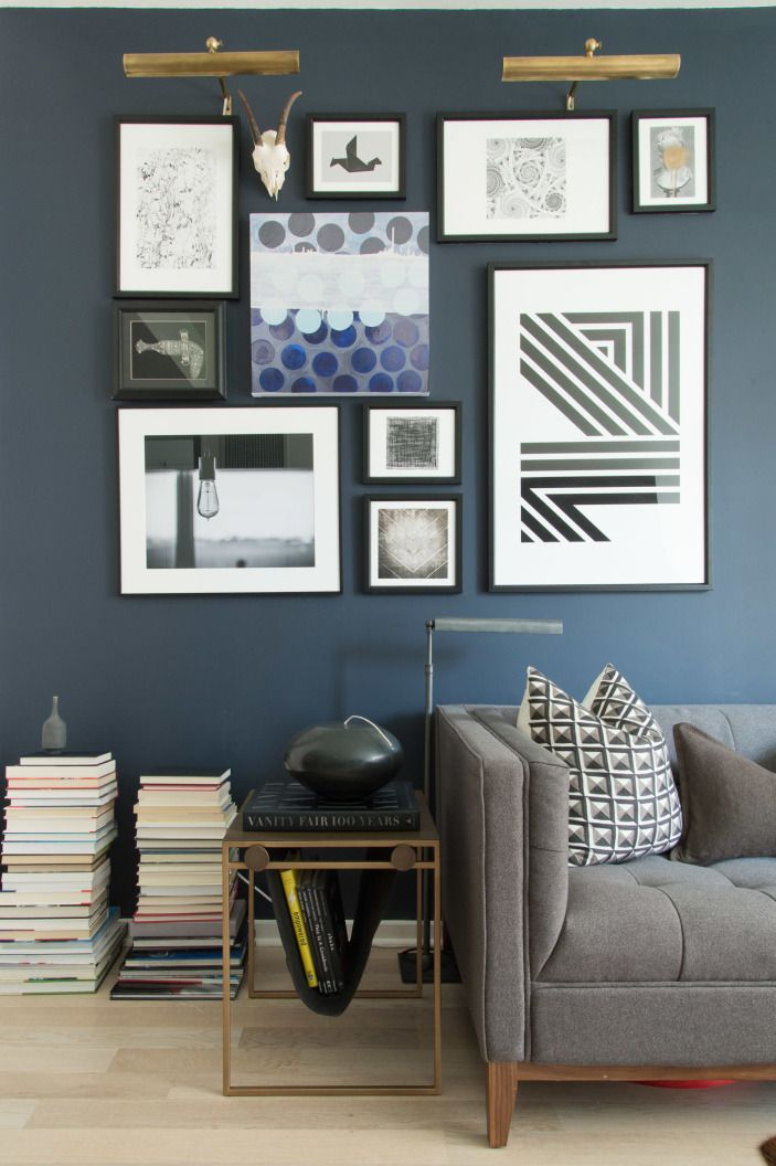 """One of Matthew's very favorite aspects of the design is the gallery wall. He chose almost all of the art and structured the layout himself. """"It tells a story with the rest of the apartment,"""" says Matthew."""