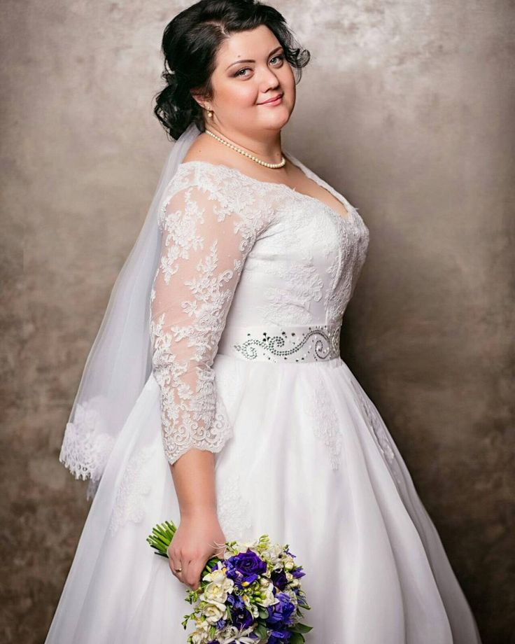 Here is a plus size wedding gown with a sheer lace sleeve.  The belted feature under the bust accentuates the figure. We can recreate plus size bridal gowns like this for you according to any of your preferences. Get affordable custom wedding dresses & #replicas of couture gowns from our USA based firm.  Pricing on plus size wedding dresses made to order are available when you email us directly from our site at www.dariuscordell.com