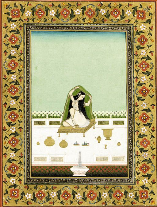 A Beauty at Her Toilette   India, Circa 1850?   Seated on a gold dais with her accoutrements before her, a partially clad beauty holds an embroidered green shawl over her head with her hair falling in loose strands at her back, the scene set on a garden terrace with rows of blooming flowers and a fountain below, framed by borders painted with scrolling foliage on a gold leaf ground, stamped on reverse Huzur Office-Miraj Junior State