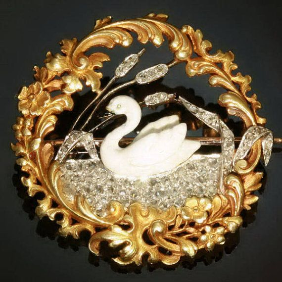 Early Art Nouveau French brooch of an enameled swan, gliding on a lake of diamonds, circa 1880