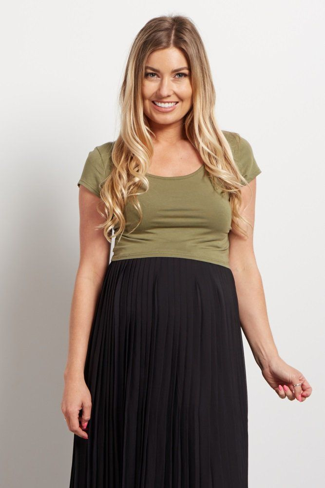 Just in time for the summer, this maternity crop top will be your new favorite essential. A short sleeve crop top with a cutout back detail for a stylish look everywhere you go. Pair this crop top with a high waisted maternity skirt and wedges for a complete ensemble.