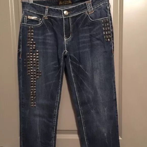 VO Virgin Only Jeans Virgin Only brand dark wash skinny jeans embellished with studs. These jeans are known for having a great stretch without stretching out during wear. In great preowned condition. Smoke free home.  Waist: 16 inches Inseam: 33 inches  * Please check out my other listings. I ❤️ to give bundle discounts. Virgin Only  Jeans Skinny