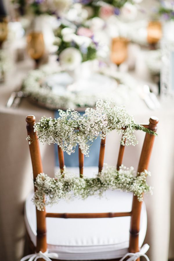 baby's breath wedding decor, photo by Emily Millay Photography http://ruffledblog.com/nautical-romance-wedding-ideas-in-charleston #babysbreath #chairswag