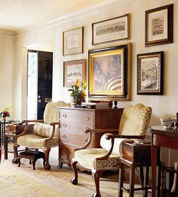 British Colonial living room grounded by a pair of 19th-century George III-style chairs.