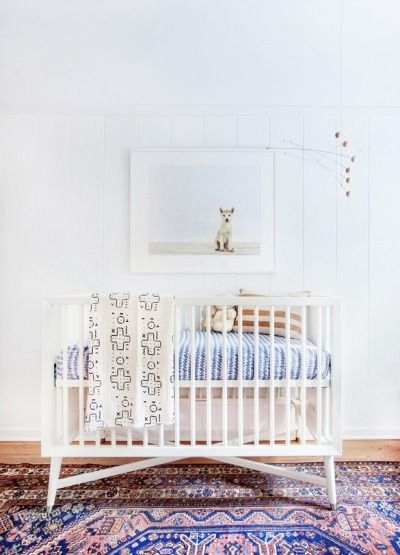 White walls and tribal rug: http://www.stylemepretty.com/living/2015/08/22/trending-sophisticated-nurseries-your-child-can-actually-grow-into/