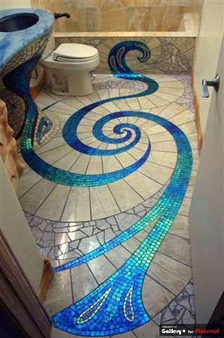 Peacock and turquoise blue mosaic tile work on bathroom floor.