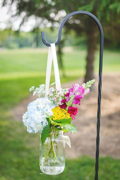 A mason jar adds a rustic touch to this floral wedding aisle marker! {An Affair to Remember}