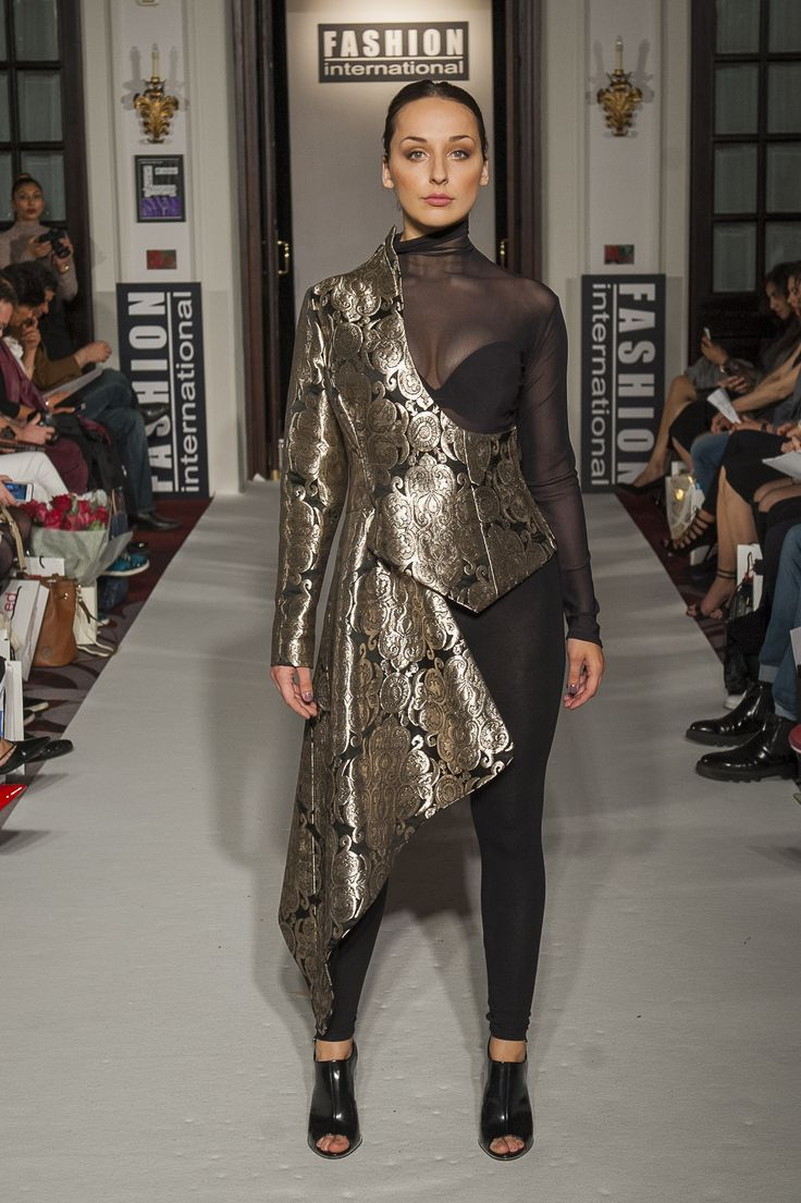 "Lenie Boya ""Dramatique"" Collection at London Fashion Week S/S 2016 Haute Couture. Gold metallic brocade asymmetric half coat with one sleeve and peaked bodice."