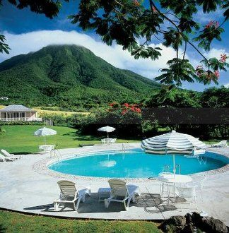 The photo shows Nevis Peak on Nevis Island, which is located near St. Kitts in the Caribbean.