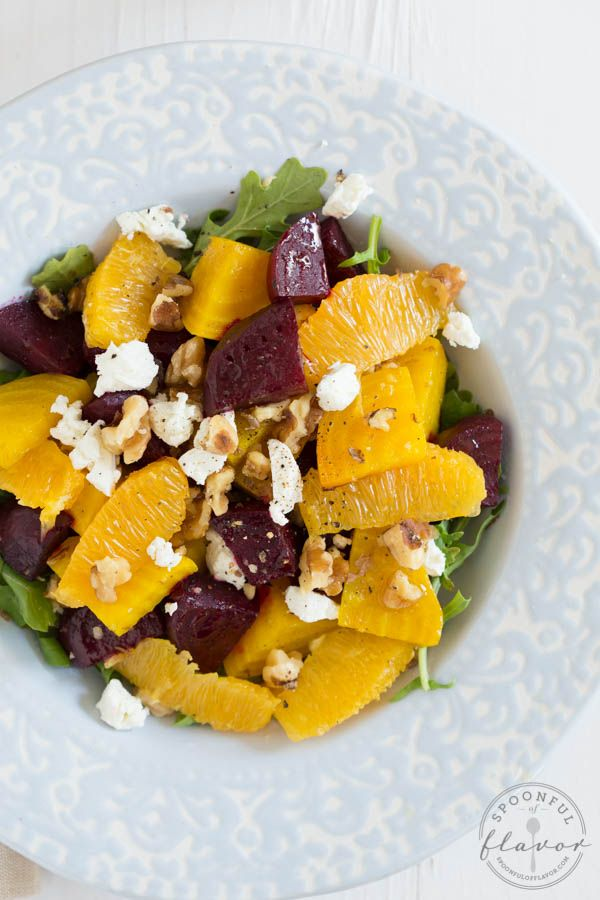 Roasted Beet and Orange Salad - roasted beets and fresh oranges are layered over a bed of arugula and topped with goat cheese, walnuts and citrus vinaigrette dressing