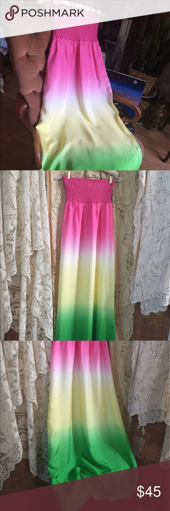 Lily Pulitzer Gradient Silk Rainbow Maxi Dress Lily Pulitzer silk maxi dress with a hotty pink stretch bandeau strapless top. Gradient classic Lilly pastels colors flow from pink to yellow into a vibrant green. This dress is fully lined from waist to hem. Never worn with tags. In near perfect, closet stored condition. Size Small Lilly Pulitzer Dresses Maxi