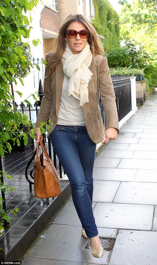 Looking fab: Elizabeth Hurley dressed up her skinny jeans when she stepped out on Tuesday in a chic blazer