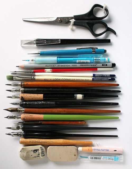 pens, pencils, brushes, scissors. You can never have enough.