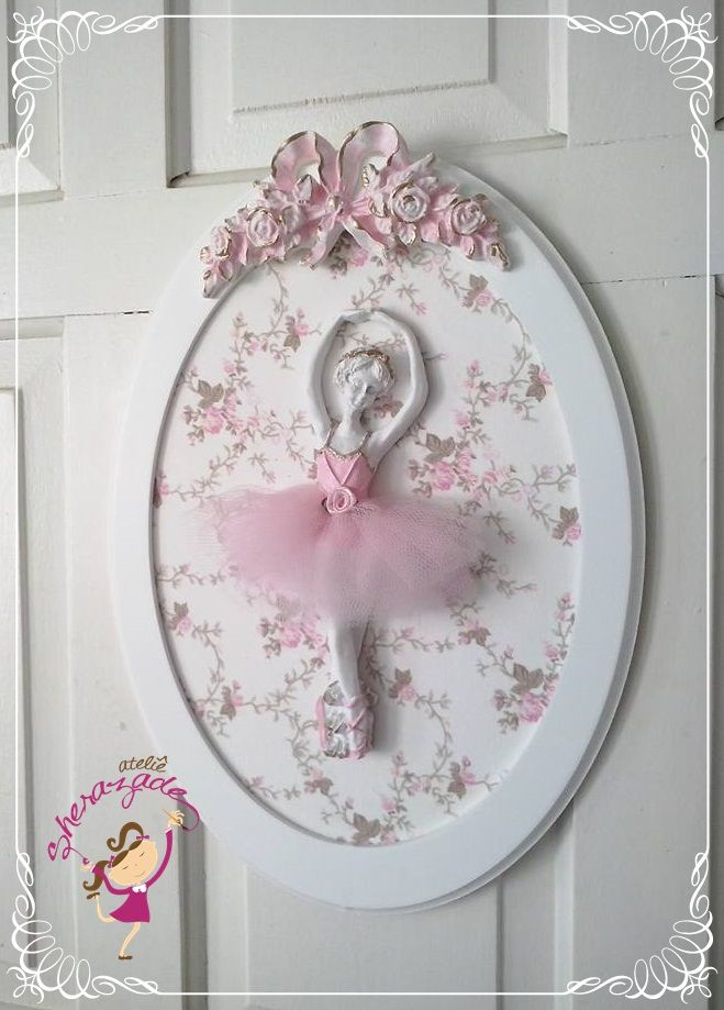 Ballerina relief with pink tulle tutu, in a white oval frame, backed in pretty floral paper, with pink ribbon bow relief at the top. Perfect decor for a young ladies room!
