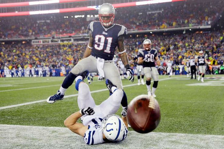 A pass gets away from Indianapolis Colts tight end Coby Fleener (80) under pressure from New England Patriots linebacker Jamie Collins (91). (Matt Slocum/AP)