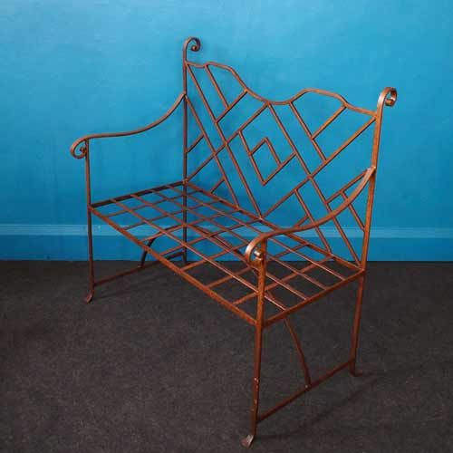 From the Charente Maritime region of France, this vintage metal bench is a stunning unusual geometric design.  Made of iron, with scroll details, this bench will live on for many many years to come, whether indoors or outdoors.  Perfect for your garden, patio, sun terrace, conservatory… wherever you choose to enjoy our glorious summer months!  107cmH – 101cmW – 57.5cmD Seat: 44cmH
