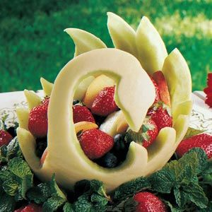 Melon Swan Fruit Bowl. My mom got me the stuff to make fruit carvings like this.