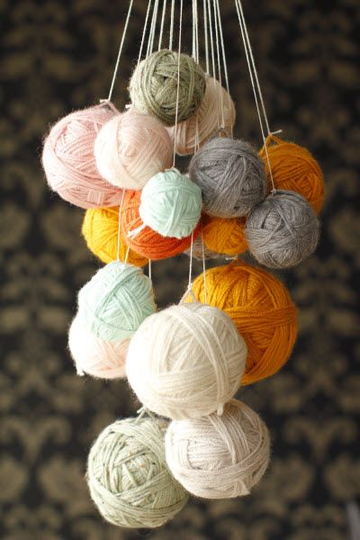 Not crochet per se, but if you're like me, you enjoy making your own home decor and admit it, your stash could use some busting (DIY Yarn Chandelier how-to from HGTV)
