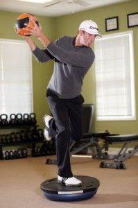 Dustin Johnson Golf fitness training for balance and rotation - Single Leg Stance On BOSU Ball With Trunk Rotation Using A Medicine Ball!