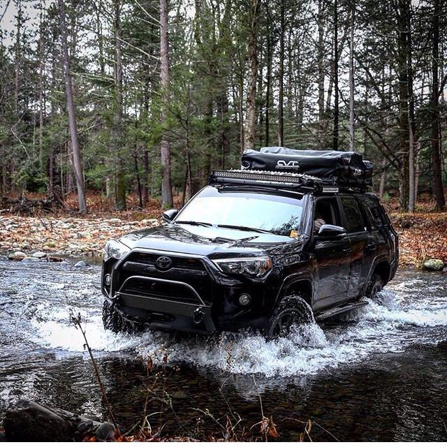 Toyota 4Runner driving thru the river