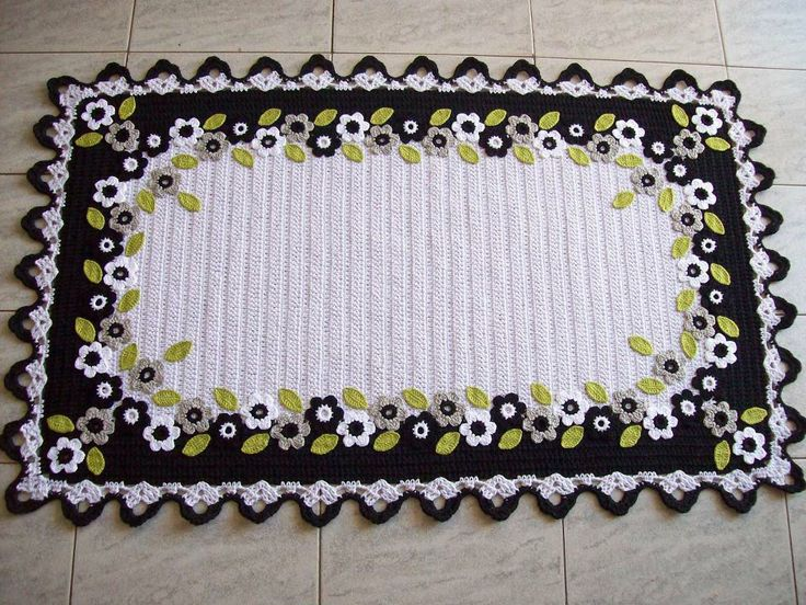 Crochet tablecloth with floral applique