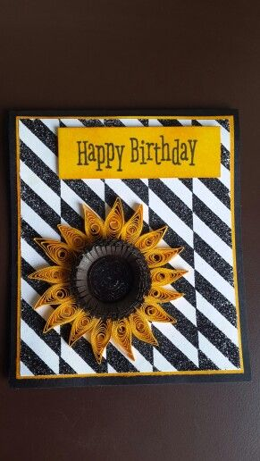 Bright sunflower quilling with glitter heat embossed background